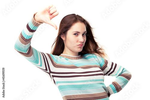 Girl showing thumb down