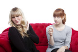 young blond and red haired girls is disgusting of smoke
