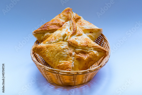 two servings khachapuri a straw plate