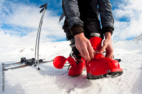 getting ready for skiing - fastening the boots - 45706529