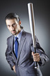Angry businessman with bat on white