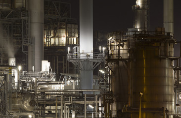 Close-up of an oil-refinery plant at night