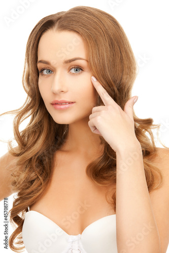 beautiful woman pointing to eye
