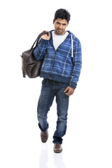 Portrait of Indian young man with travel bag
