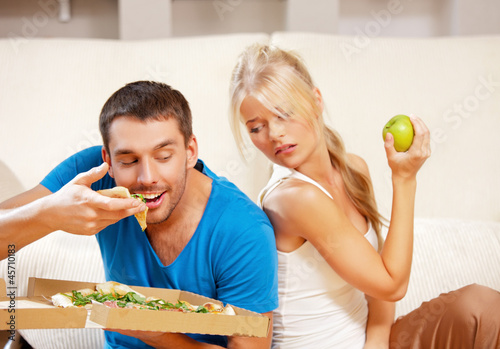 couple eating different food
