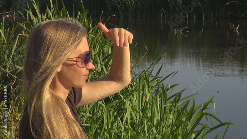 Beautiful woman relaxing near to a lake