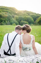 Groom and Bride in a park.