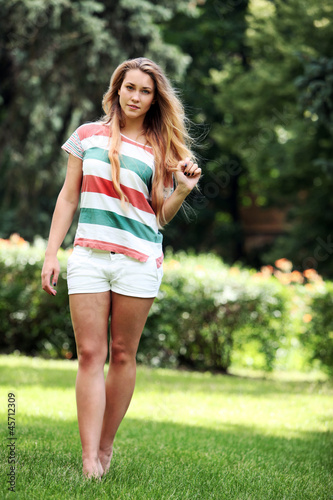 Beautiful woman walking in the park