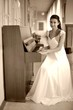 Retro bride playing piano
