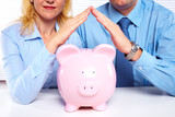 Couple with a piggy bank.