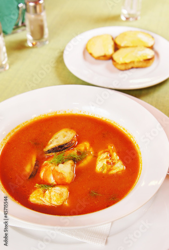 Bouillabaisse - Tomato soup with seafoods in a plate