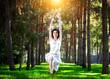 Yoga warrior pose in park