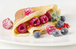 Crepes with raspberries and blueberries