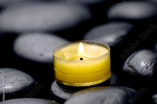 Meditation candles burning on pebbles