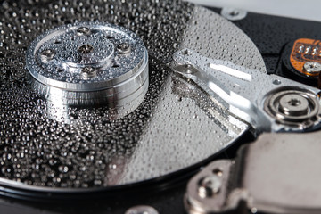 Hard disk drive with water drops.