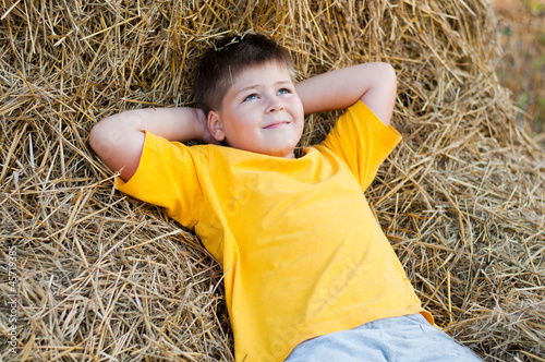 Boy lying on the straw