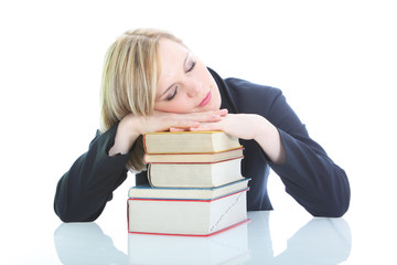 Tired blonde woman sleeping on books