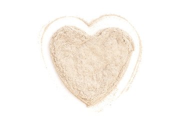 Heap ground White Pepper isolated in heart shape on white backgr