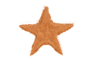Heap of ground Cinnamon isolated in star shape on white backgrou