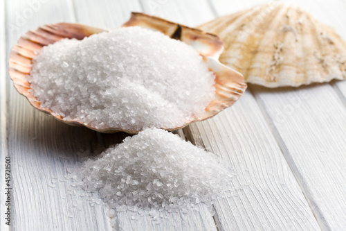white crystal salt in seashell