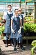 group gardeners portrait in greenhouse