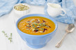 Pumpkin soup with pumpkin oil and seeds