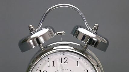 Vintage alarm clock in time lapse