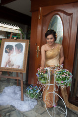 asian thai bride in thai wedding suit smiling in wedding ceremon