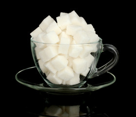 refined sugar in glass cup isolated on black background