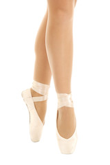ballerina's feet in pointe on white background close-up