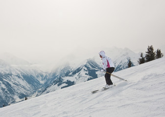 A woman is skiing at a ski resort.