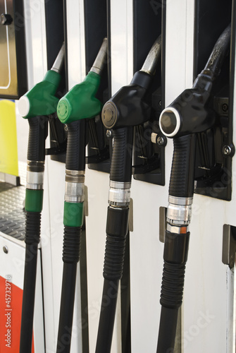 Pump nozzles at the gas station (selective focus)