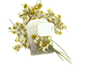 bag of chamomile tea on white background