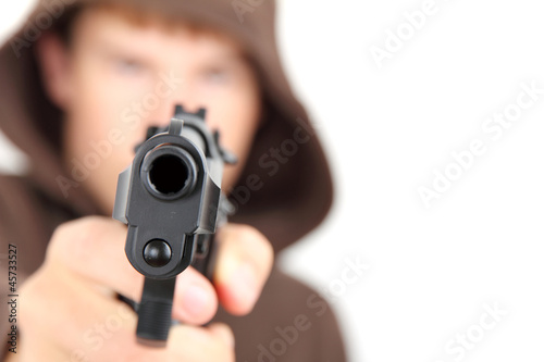 A teenager wearing a hood aiming a gun with white background