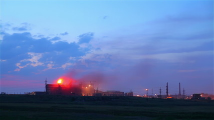 A big fire burning in a industrial buildings