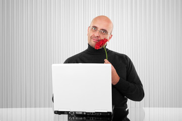 Romantic bald man with red flower
