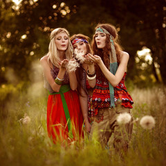 Girls of hippie in the field