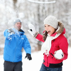 Winter fun - couple in snowball fight