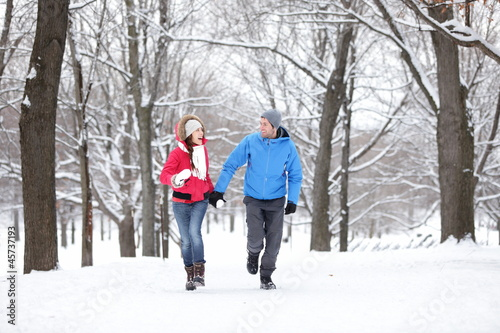 Couple walking in winter forest
