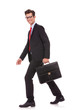 business man holding a briefcase and walking