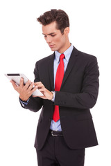 young business man working on his tablet pad