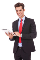 smiling business man using his tablet pad