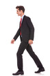 side view of a business walking forward