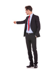 business man pointing at his back