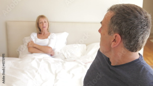 Senior Couple Arguing In Bedroom
