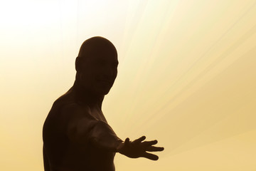 Man's silhouette on a rays yellow background