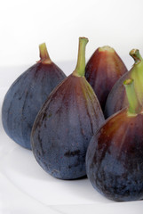 Whole, organic figs on a white plate