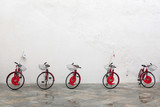 Red bicycle on a white wall