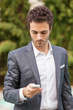 Young Businessman  with Mobile Phone