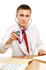 Male doctor using stethoscope at desk
